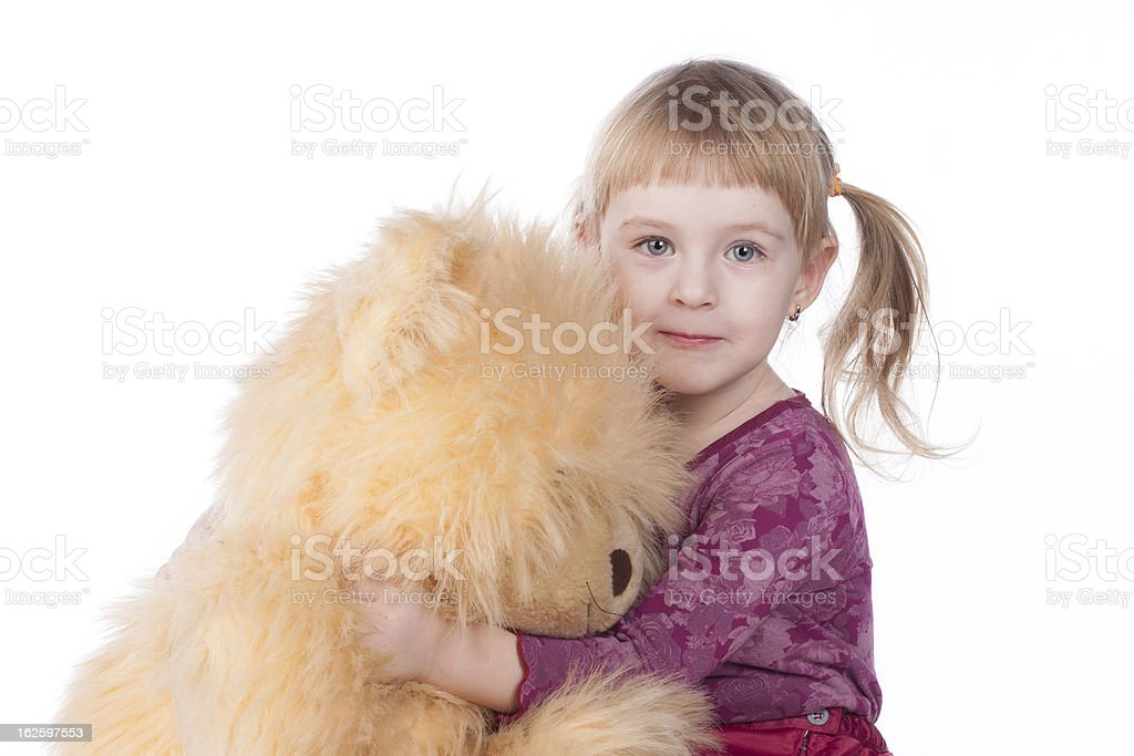 sweet baby girl hugs her teddy and smiles royalty-free stock photo