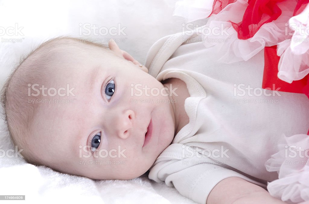 Sweet baby girl with almost smile. royalty-free stock photo