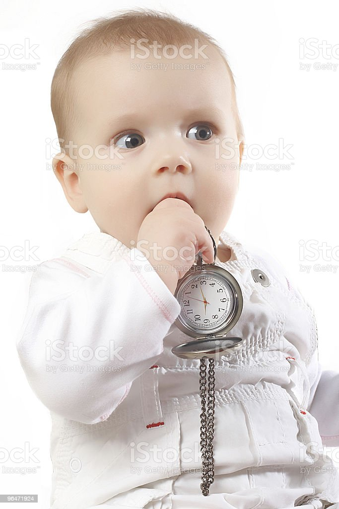 sweet baby holds pocket watches royalty-free stock photo