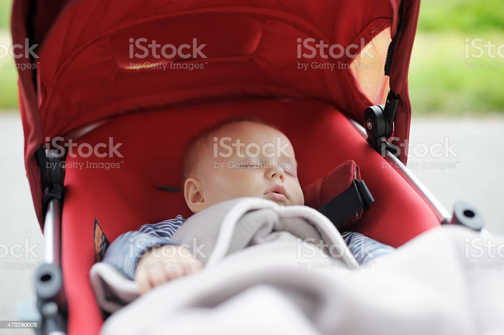 Sweet baby in stroller stock photo