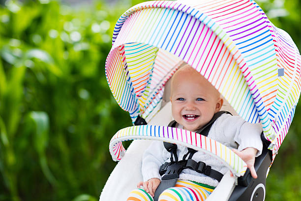 Sweet baby in white stroller stock photo