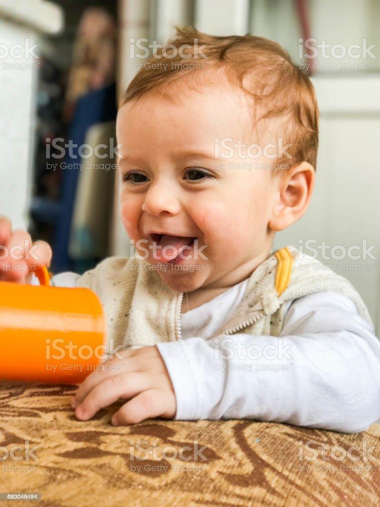Sweet baby playing toys cup foto de stock libre de derechos