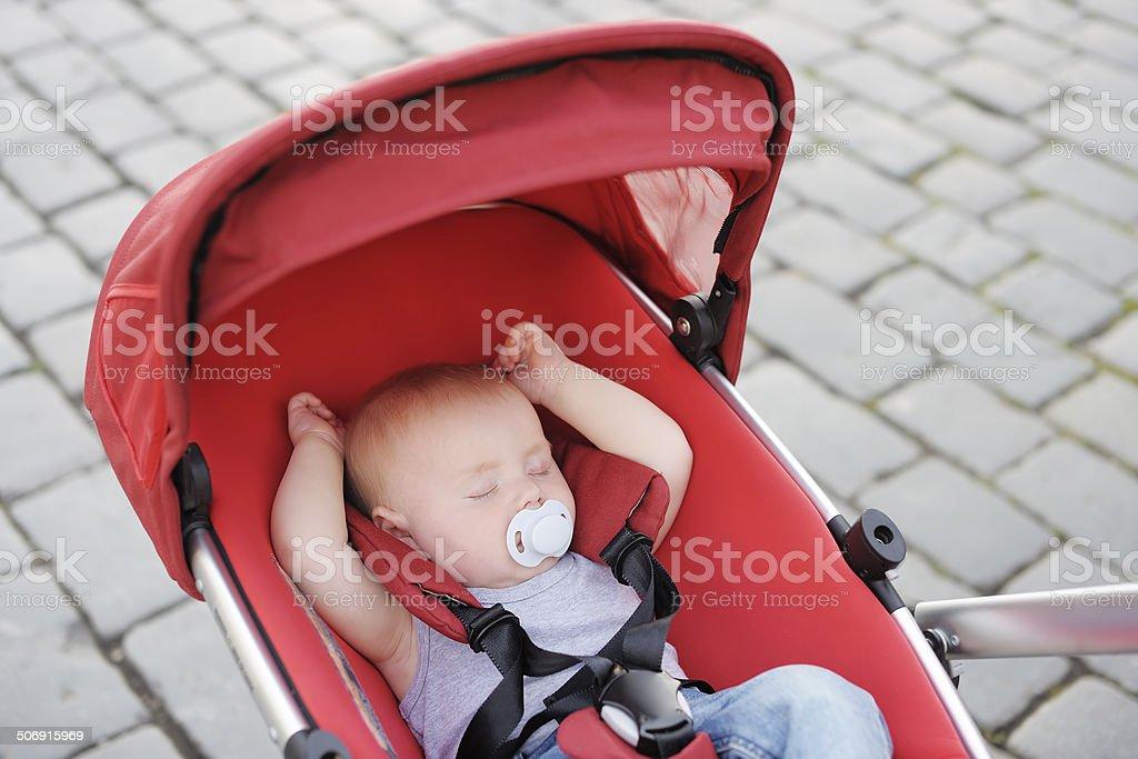 Sweet baby sleeping in stroller stock photo