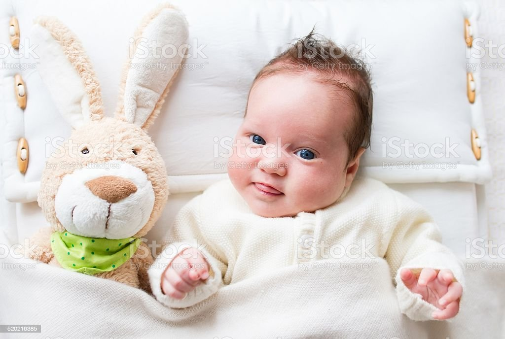 Sweet baby with toy bunny stock photo