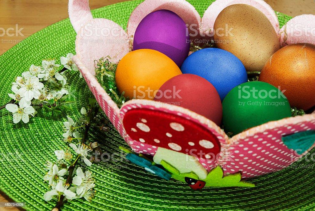 Sweet basket full of eggs stock photo