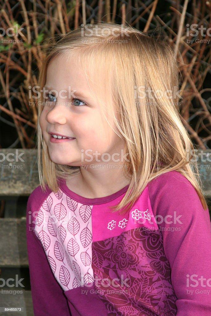sweet blond girl smiling royalty-free stock photo