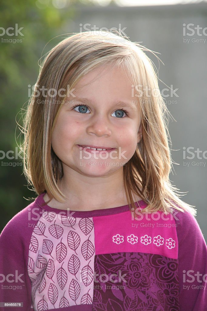 sweet blond girl smiling stock photo
