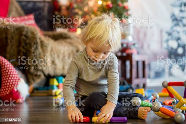 Sweet blonde toddler boy playing with plastic construction making picture id1194326779?b=1&k=6&m=1194326779&s=612x612&h=nnrmammeadhdocjibvgadot1op9ktx65lp4vcxjsiqu=