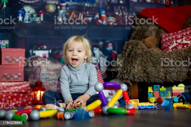 Sweet blonde toddler boy playing with plastic construction making picture id1194326994?b=1&k=6&m=1194326994&s=612x612&h=psio10bg6k8gazvci4rifotjsiyywlt4vr5j pbobxq=