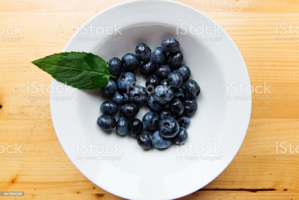 Sweet blueberries on wooden table stock photo