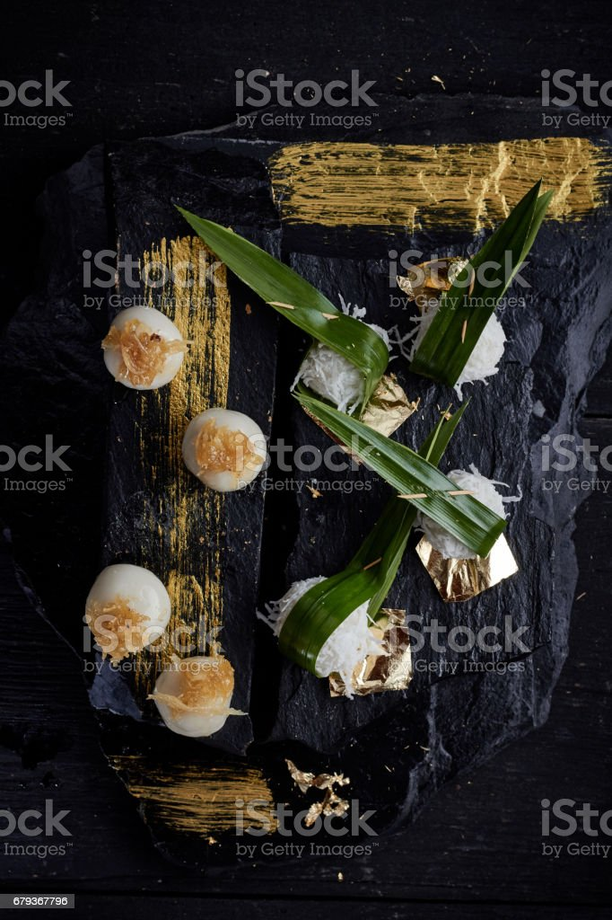 Sweet boiled ball dessert,roll over the grated coconut. royalty-free stock photo