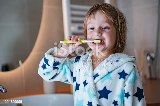 948443044 istock photo Sweet boy is brushing his teeth before bed time 1224829958
