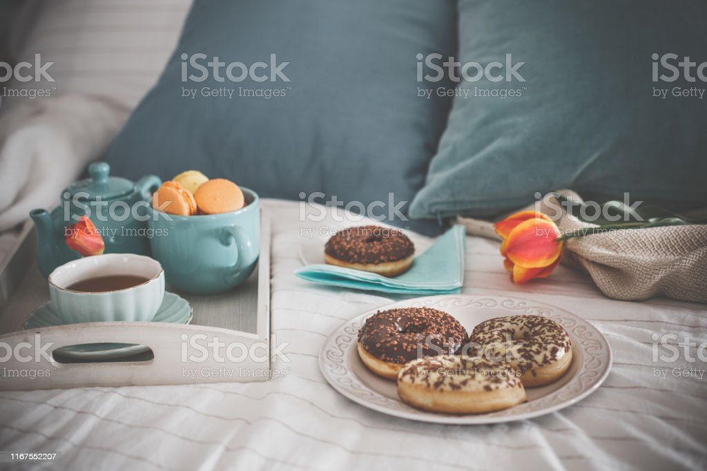 Shot of delicious and sweet breakfast served in bed. There is a tray...
