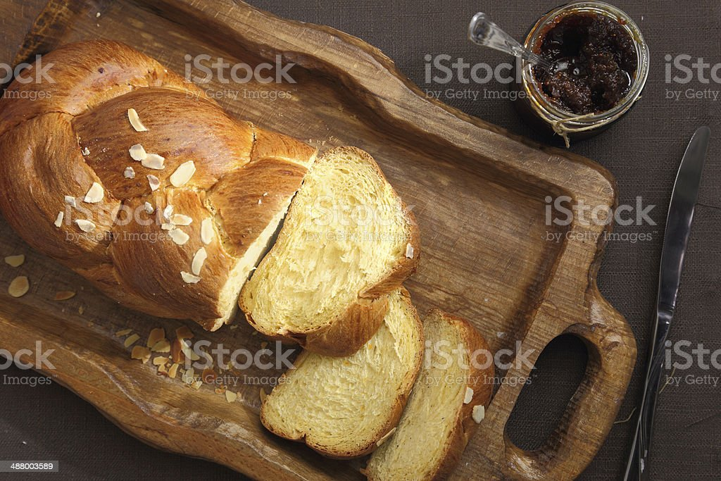 Sweet brioche bread on tray with knife and marmalade stock photo
