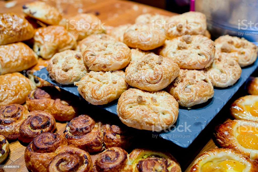 Sweet buns on cutting board. stock photo