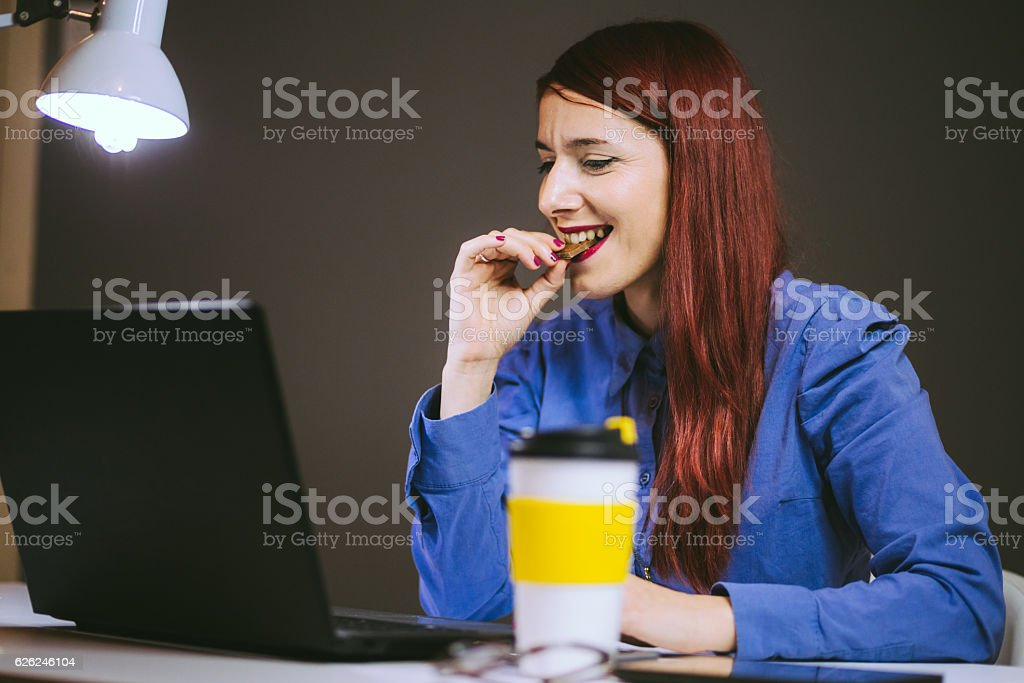 Sweet Business Lady Eating Chocolate stock photo