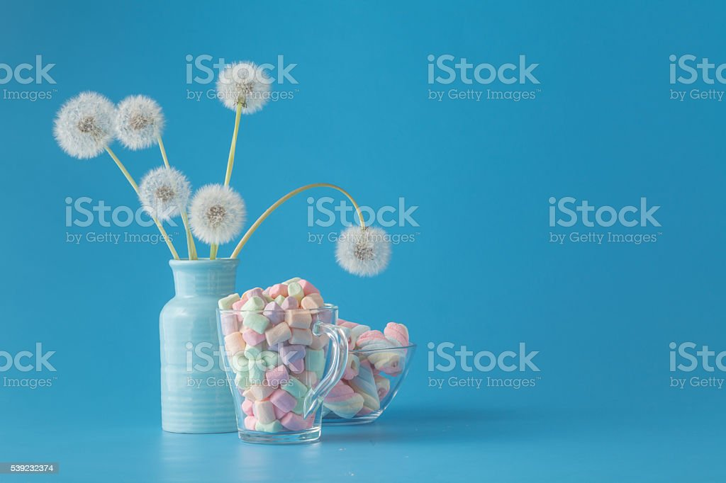 Sweet candies on blue color table foto royalty-free