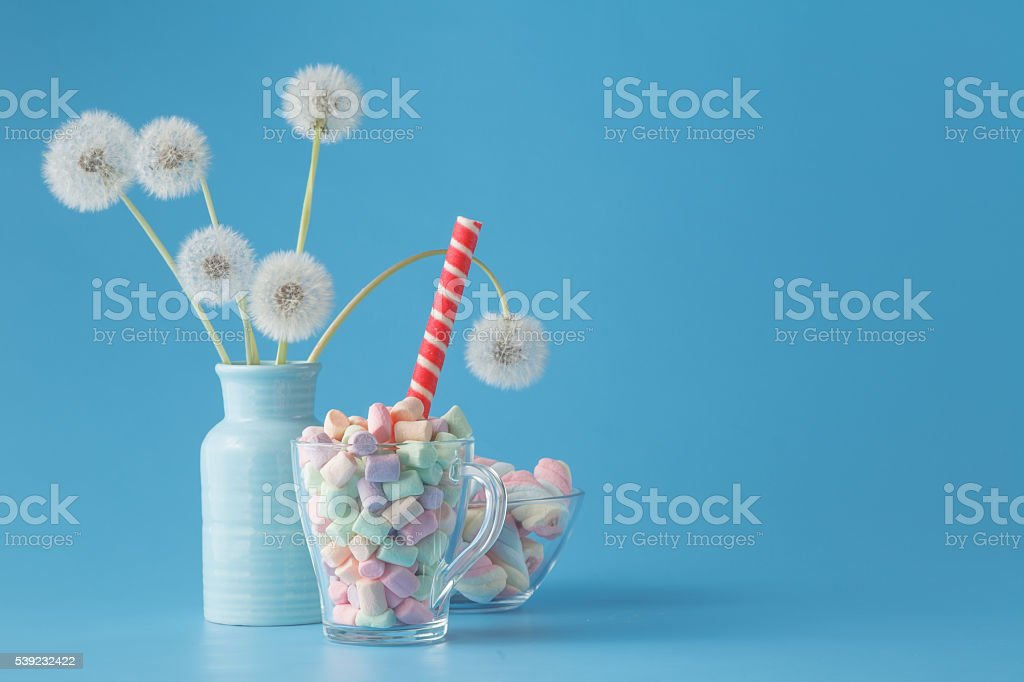 Sweet candies on blue color table foto de stock libre de derechos