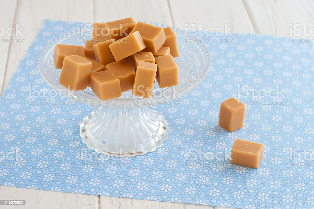 Sweet caramel toffees, fudges on an etagere stock photo