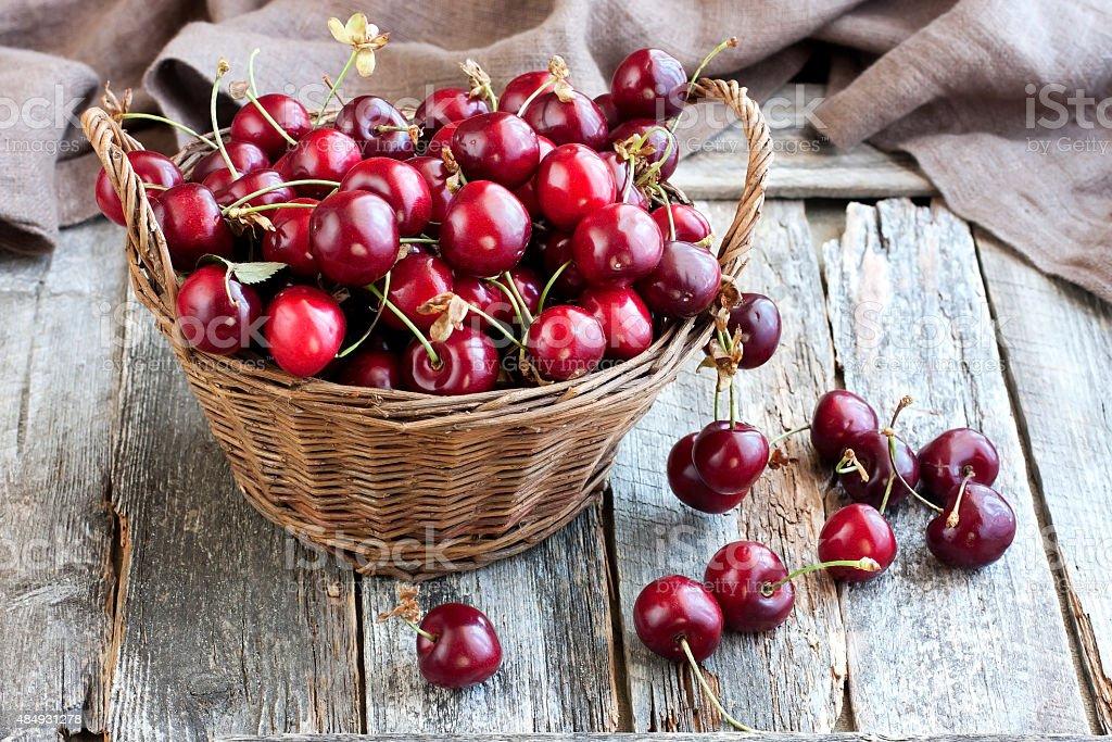 Sweet cherries in  basket stock photo