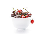 Sweet Cherries in bowl. Fresh cherries isolated on white background.