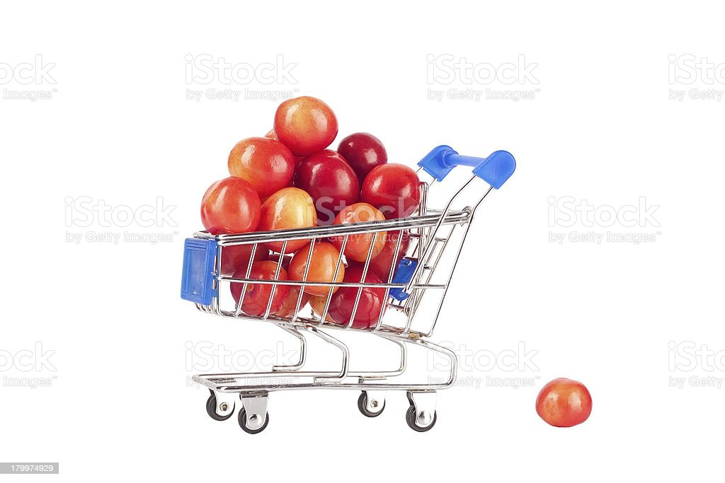 Sweet cherries in shopping cart royalty-free stock photo
