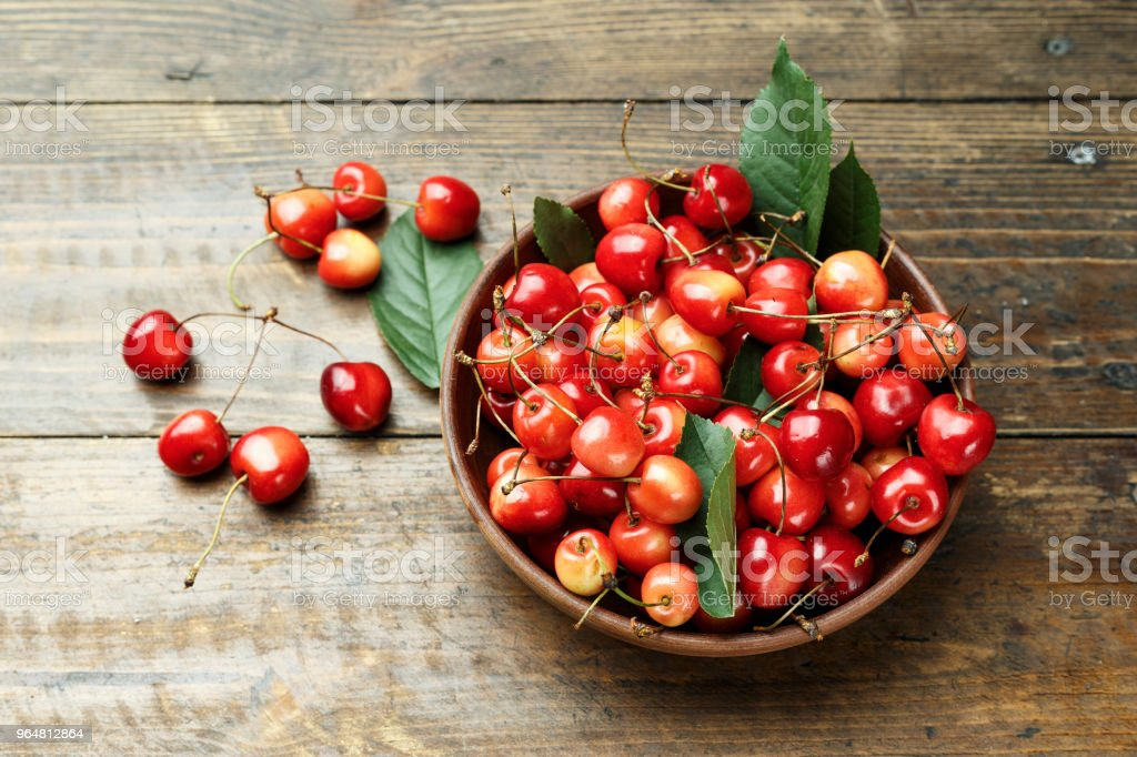 sweet cherry on a wooden background. royalty-free stock photo