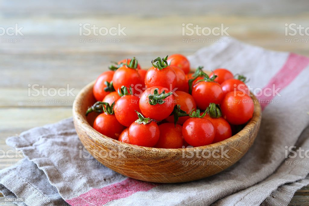 Sweet cherry tomatoes in a bowl stock photo