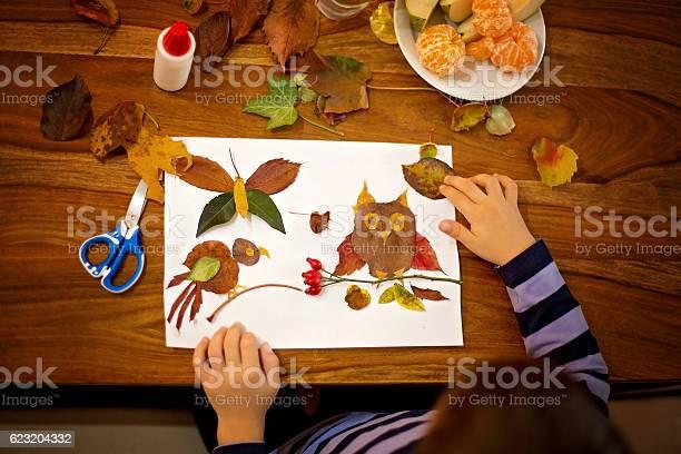 Sweet child boy applying leaves using glue while doing arts picture id623204332?b=1&k=6&m=623204332&s=612x612&h=o1gnfwb6rpuakiwmqw ih3xrxuenaaymnyfbyijnqfk=