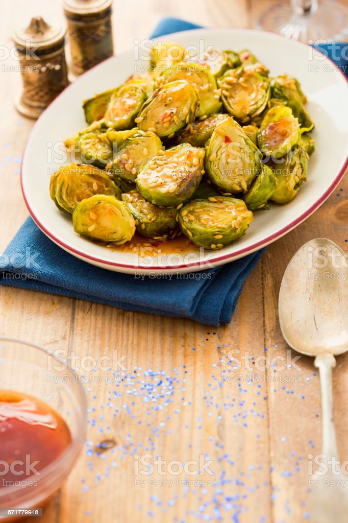 Sweet chilli brussel sprouts stock photo