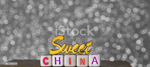 istock sweet china written text and beautiful background,Chinese sweet food,lovely china food,holiday Chinese food 1186255024