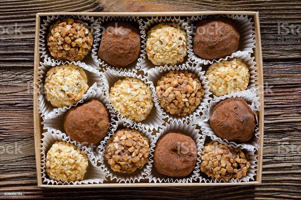 Box of chocolates, various chocolate truffles, white chocolate and...