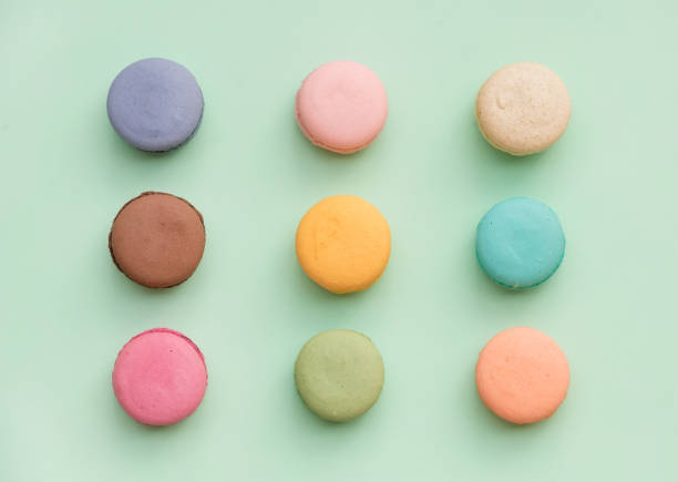 Sweet colorful French macaroon biscuits on pastel mint background ストックフォト