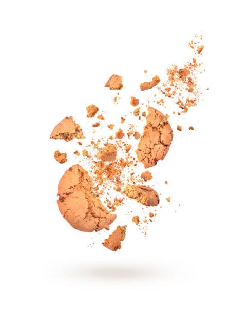sweet cookies in dynamics on white background - briciola foto e immagini stock