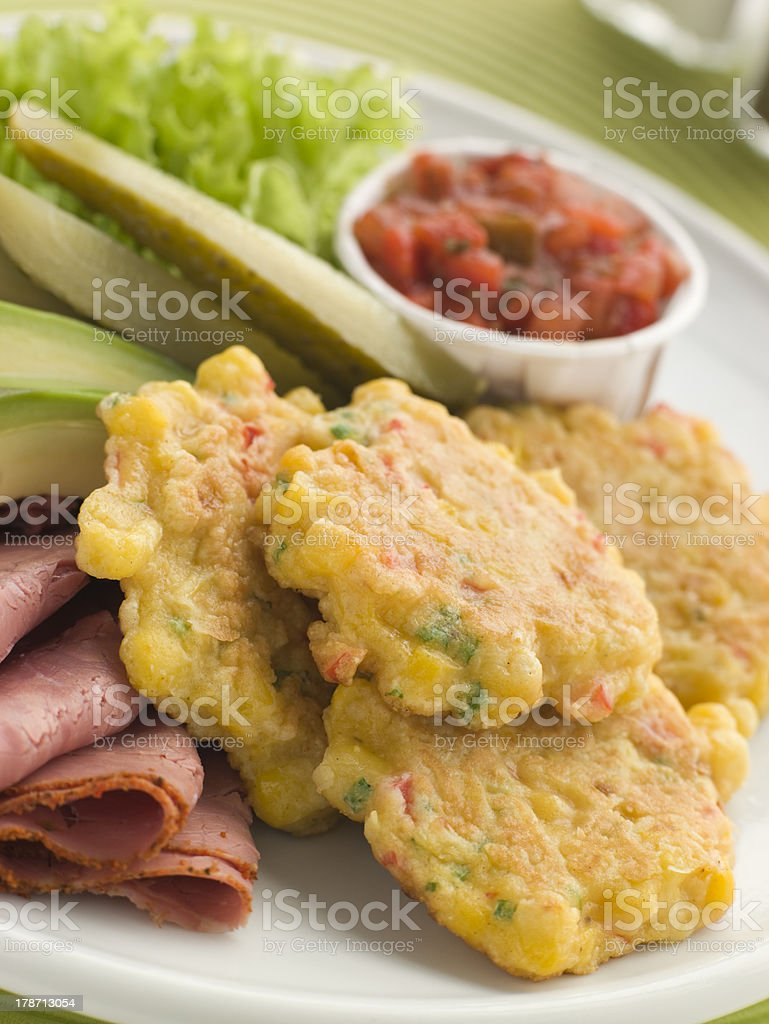Sweet corn Fritters with Salsa Gherkins Avocado and Pastrami stock photo