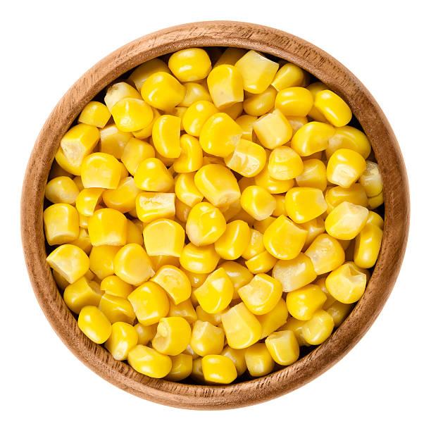 sweet corn kernels in wooden bowl over white - milho imagens e fotografias de stock