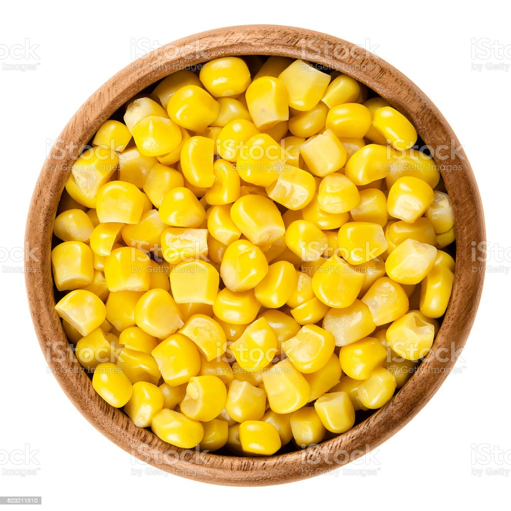 Sweet corn kernels in wooden bowl over white stock photo