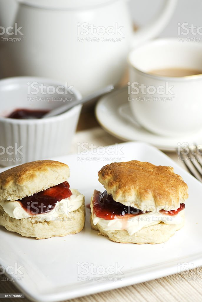 Sweet cream teas served on delicate white China stock photo
