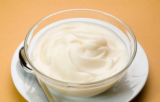 Sweet cream with milk stock photo