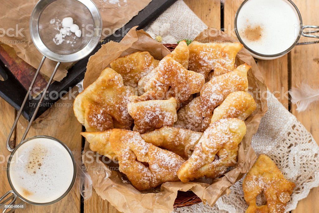 Sweet crisp pastry Angel wings with powdered sugar stock photo