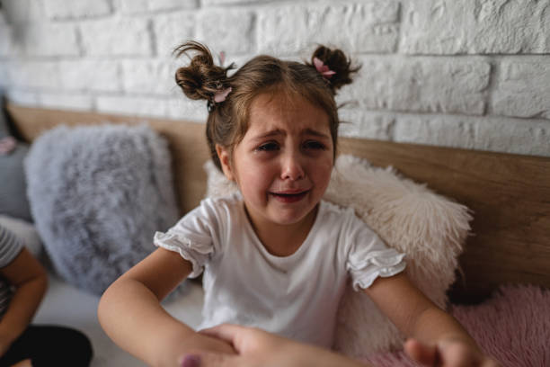 Sweet crying girl wanting her mom stock photo