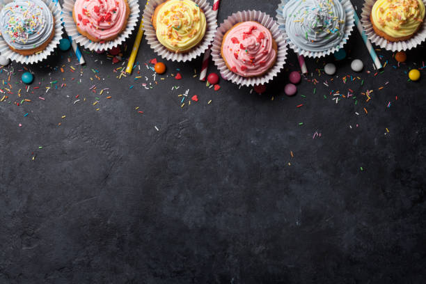 Sweet cupcakes Sweet cupcakes with colorful decor and candies. Top view with space for your greetings cupcake stock pictures, royalty-free photos & images