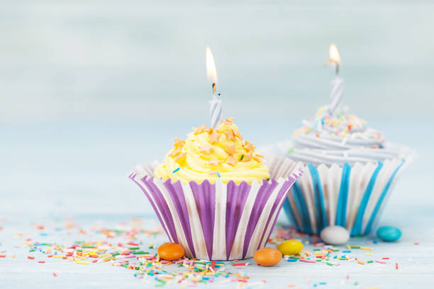sweet-cupcakes-with-candles-picture-id957160150