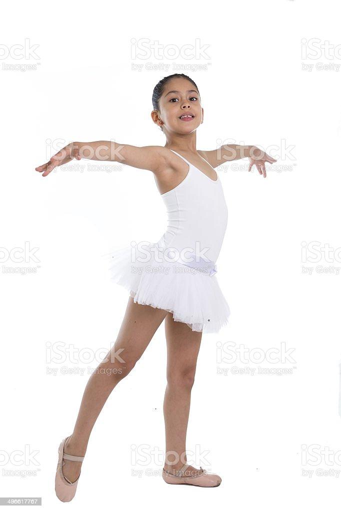 sweet cute little girl ballet dancer dancing on white background stock photo