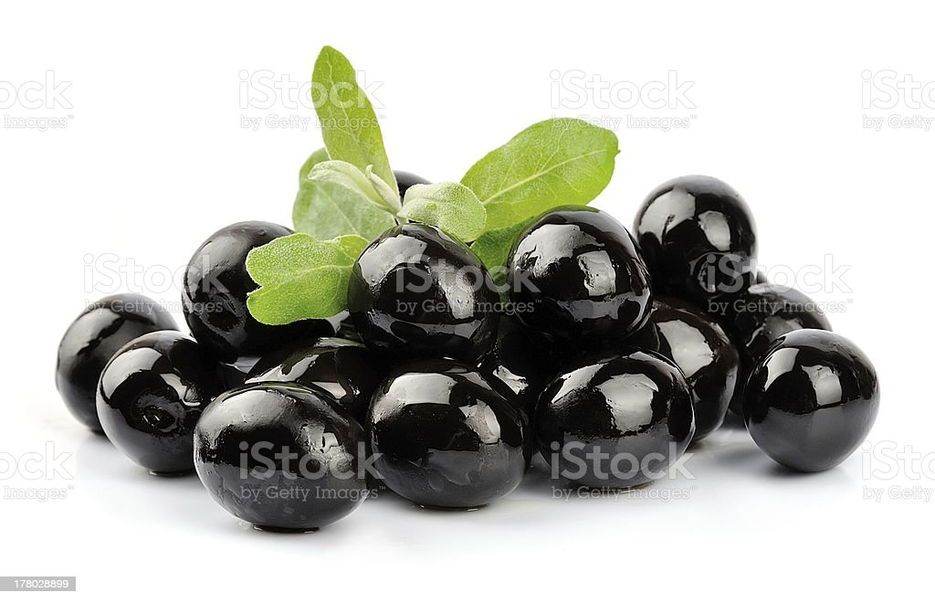 Sweet dark olives on a white background stock photo