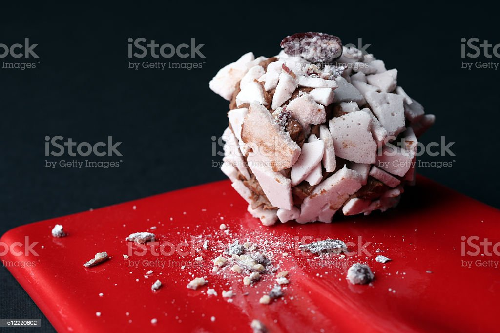 Sweet dessert. Delicious meringue on the red plate, black background stock photo