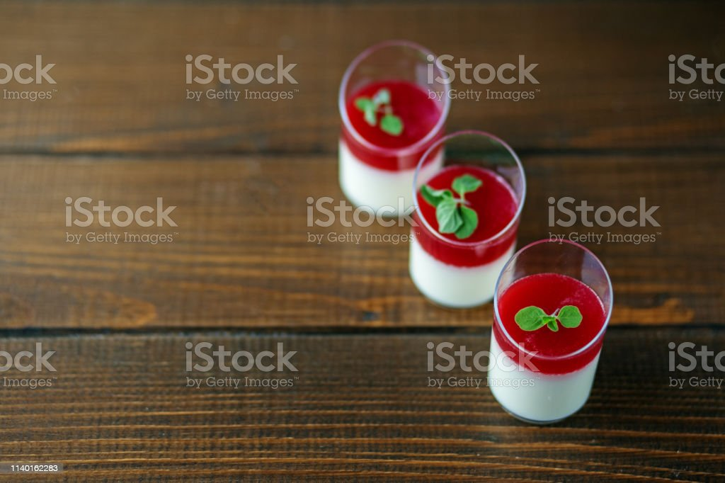 Sweet dessert in cups on wooden background. Copy space. Concept of...