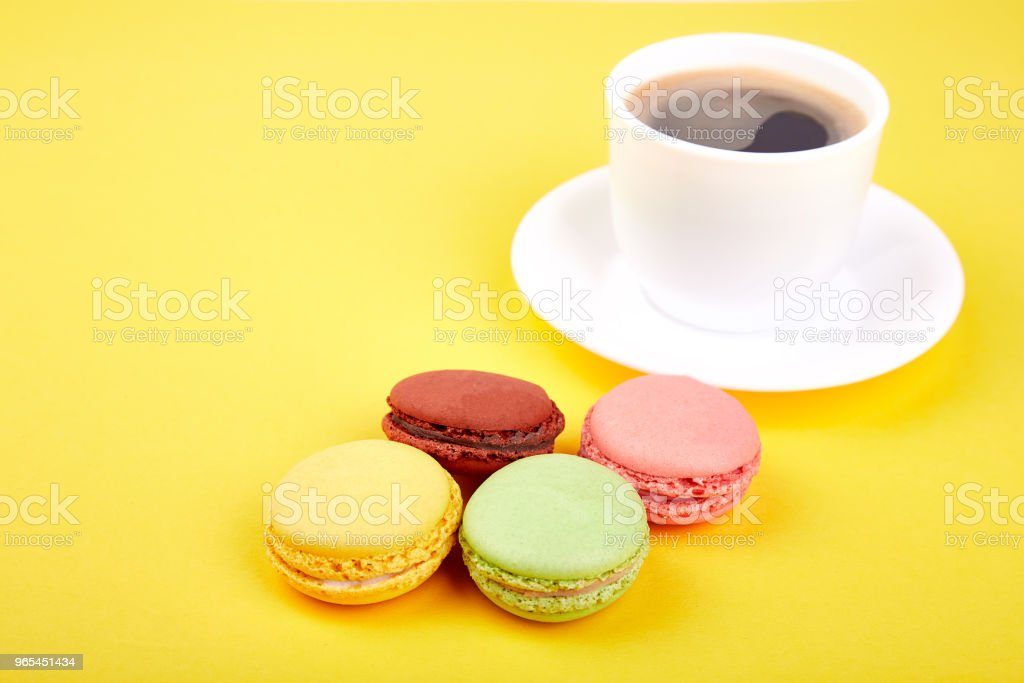 Sweet Dessert Macaron or macaroon with coffee royalty-free stock photo