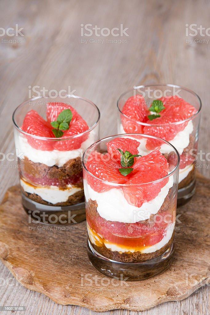 Sweet dessert tiramisu with fresh grapefruit royalty-free stock photo