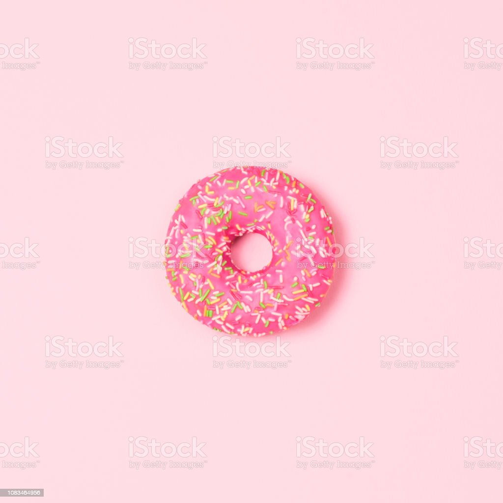 Sweet donut on pastel pink background. Top view. Flat lay. Food...